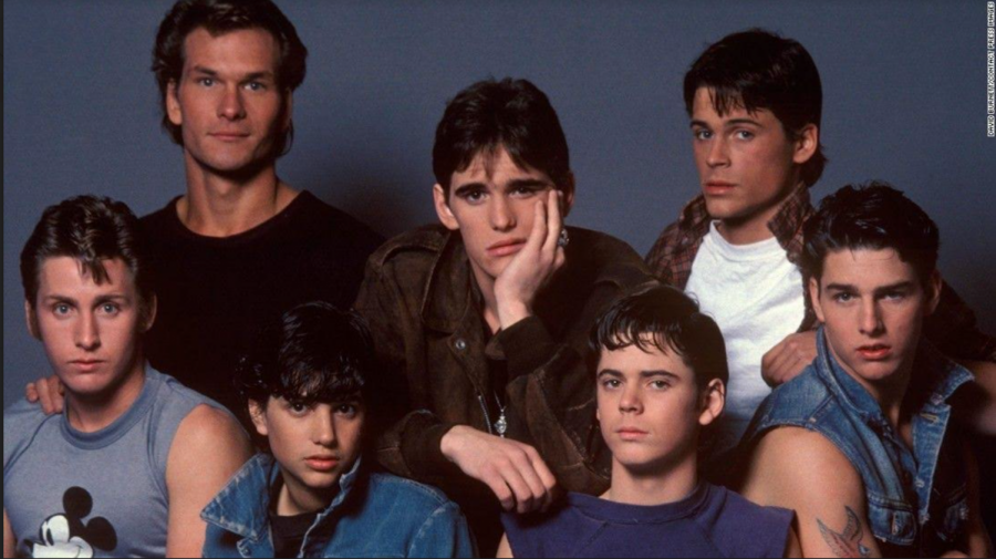 The cast of The Outsiders- Patrick Swayze, Matt Dillon, Rob Lowe, Emilio Estevez, Ralph Macchio, C. Thomas Howell, and Tom Cruise- pose for a promotional photo in 1983.