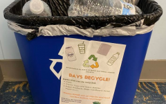 A recycling bin with the advertisement designed by Grace Fields.